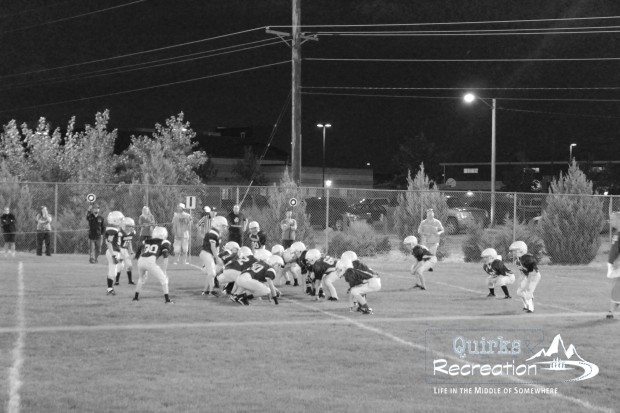 Sixth grade football scrimmage showing offense/defense on the line